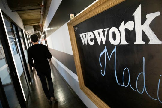 This Tuesday, Nov. 5, 2019, photo shows a WeWork office space in New York. WeWork said Friday, Nov. 8 it will divest from several side businesses and cut jobs as part of a 90-day plan to turn itself around following its botched attempt to sell stock on Wall Street.