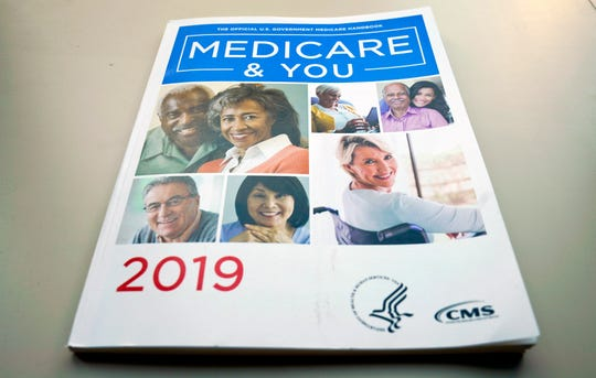 FILE - In this Nov. 8, 2018, file photo, the U.S. Medicare Handbook is photographed, in Washington.