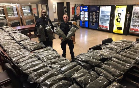 Officers stand by what they thought was marijuana when they confiscated in the Brooklyn borough of New York on Saturday, Nov. 2, 2019, at the 75th Precinct of the NYPD in New York.
