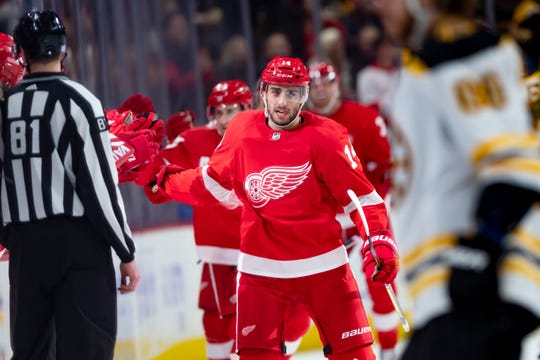 Detroit center Robby Fabbri high-fives his new teammates after scoring his second goal of the game. It was Fabbri's first game as a Red Wing.