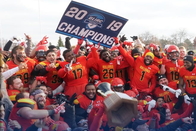 Ferris State players celebrate after Saturday's 21-16 win over Grand Valley State
