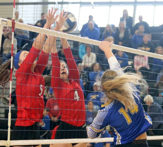 Owego's Mackenzie Struble (5) and Haleigh Whatley (4) go for the block against Maine-Endwell's Ashlynn Rutkowski in the Section 4 Class B championship match Nov. 9, 2019 at Corning-Painted Post High School.