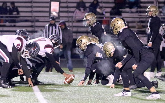 Corning's defense lines up against Elmira in a 14-12 win in the Section 4 Class AA football championship game Nov. 8, 2019 at Corning Memorial Stadium.