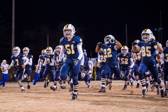 The Castle Knights take the field during the IHSAA Class 5A sectional championship against the Bloomington South Panthers at John Lidy Field in Newburgh, Ind., Friday, Nov. 8, 2019.
