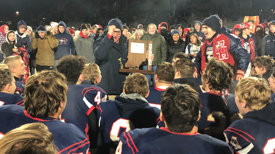 Heritage Hills coach Todd Wilkerson gives a pep talk to his team after winning the Class 3A sectional title over Southridge Friday.