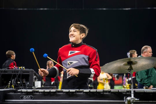 Harrison Warrior Command's Zach Owen, eighth grade, shines at the ISSMA State Marching Band Finals where Harrison took 9th place in the Class B competition at Lucas Oil Stadium in Indianapolis, Saturday afternoon.