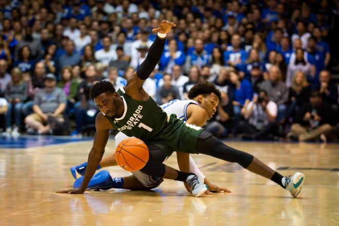 CSU's Kris Martin (1) dives for a loose ball during the Rams game against Duke in Cameron Indoor Stadium on Nov. 8, 2019.