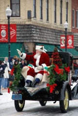 Santa waves during the parade that's an annual part of Christmas By the Bay in Sturgeon Bay.