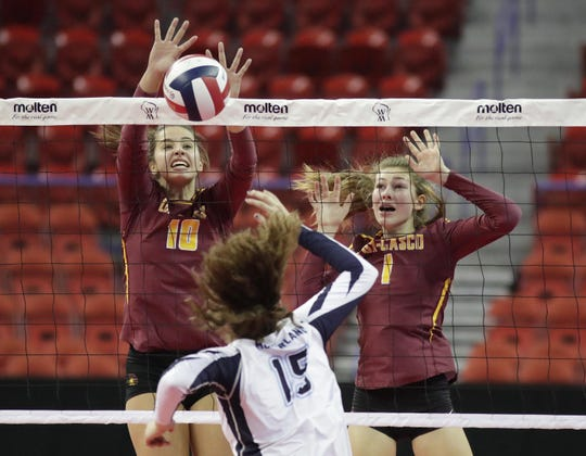Luxemburg-Casco's Holly Baierl (10) and Grace Holschuh (1) block a shot from McFarland's Katie Hildebrandt (15, bottom) during the WIAA Division 2 state championship volleyball match Saturday at the Resch Center.