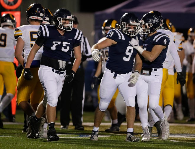 Bay Port players celebrate a play during a WIAA Division 1 football quarterfinal against Milwaukee Marquette on Friday.
