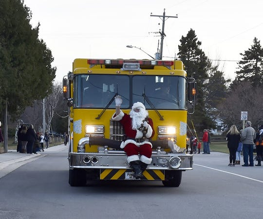 Santa rides a 400-horse open sleigh - well, a Baileys Harbor fire engine - as part of a past Harbor Holiday parade in Baileys Harbor.