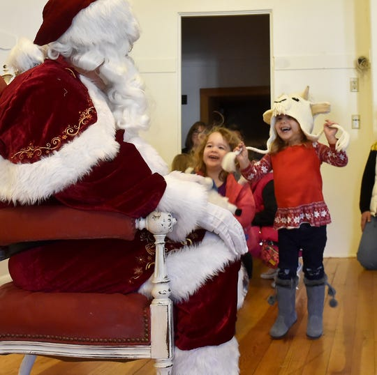 Tea and Mili Vukovic of Mt. Prospect, Illinois, were thrilled to see Santa at a past Christmas In the Village celebration in Ephraim.