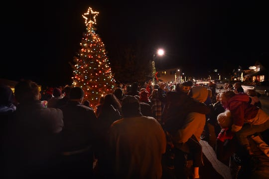 A crowd checks out the Christmas tree lighting at Harbor View Park during a past Holly Days celebration in Egg Harbor.