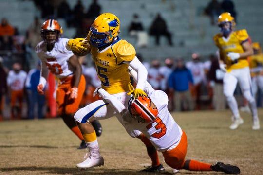 Orangeburg-Wilkinson's Edward Williams (3) grabs Wren's Tyler Cherry (15) during the game at Wren High School Friday, November 8, 2019.