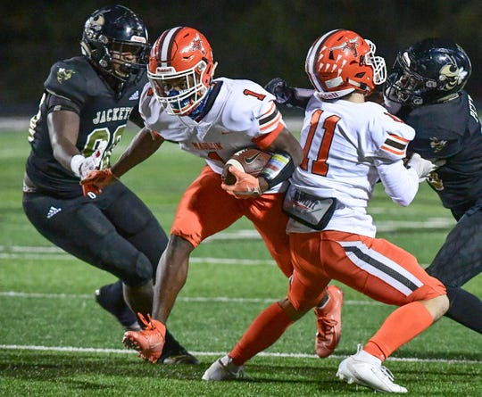 Mauldin's George Ford (1) runs against T.L. Hanna High School during the third quarter at T.L. Hanna High School in Anderson Friday, November 8, 2019.