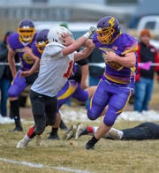 Big Sandy's Kade Strutz carries the football as Roy-Winifred's Calvin Rowell attempts to make the tackle during Saturday's game in Big Sandy.