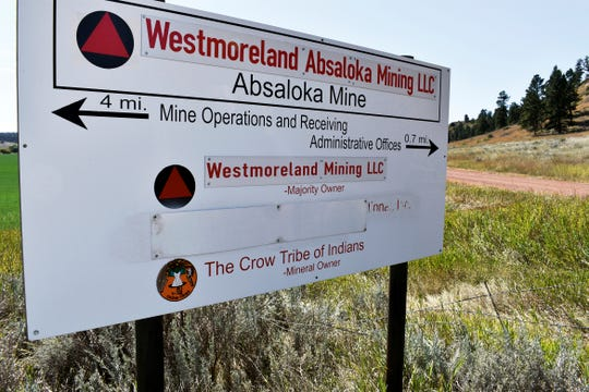 This Sept. 19, 2019 photo shows an entrance to a Westmoreland Energy coal mine on the Crow Indian Reservation near Sarpy Creek in eastern Montana. When Westmoreland Energy, a coal company,  dug up a huge bison killing grounds on the reservation with a backhoe to make way for mining, investigators determined the damage violated federal law and would cost $10 million to repair, documents show. But nothing happened - no fines, no repairs and no compensation.   (AP Photo/Matthew Brown)