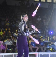 Christina Holt as one half of Bing, Bam, Boom juggles during a Super American Circus show at the University of Guam Calvo Field House in Mangilao, Nov. 9, 2019.
