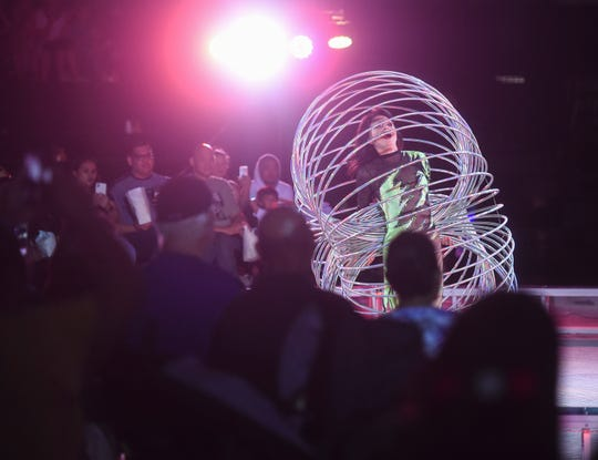 A circus act dazzles the Guam crowd with multiple hula hoops during a Super American Circus show at the University of Guam Calvo Field House in Mangilao, Nov. 9, 2019.