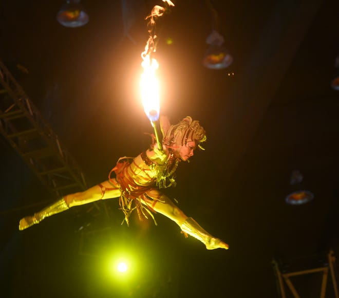 A circus performer gives a fire show during a Super American Circus show at the University of Guam Calvo Field House in Mangilao, Nov. 9, 2019.