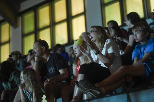 Crowd members react to a Super American Circus performance at the University of Guam Calvo Field House in Mangilao, Nov. 9, 2019.
