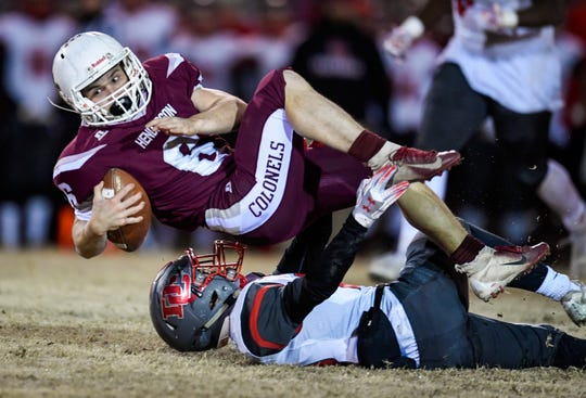 Henderson's Logan Green (6) spins over Daviess County's Parker Crews (25) for extra yards as the Henderson County Colonels play the Daviess County Panthers in the first round of the 6-A playoffs at Henderson's Colonel Field Friday evening, November 8, 2019.
