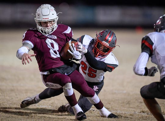 Henderson's Ben Dalton (8) runs hard against defense from Daviess County's Parker Crews (25) as the Henderson County Colonels play the Daviess County Panthers in the first round of the 6-A playoffs at Henderson's Colonel Field Friday evening, November 8, 2019.