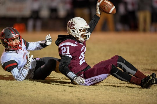 Henderson's Myekel Sanners (21) reacts after scoring a fourth quarter touchdown as the Henderson County Colonels play the Daviess County Panthers in the first round of the 6-A playoffs at Henderson's Colonel Field Friday evening, November 8, 2019.