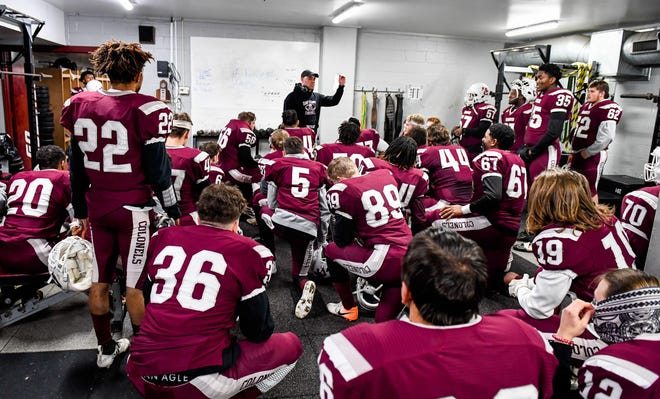 Henderson County head coach Josh Boston talks to the team during halftime as the Henderson County Colonels play the Daviess County Panthers in the first round of the 6-A playoffs at Henderson's Colonel Field Friday evening, November 8, 2019.