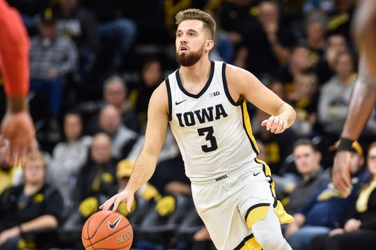 Hawkeyes guard Jordan Bohannon (3) controls the ball against the SIU Edwardsville Cougars during the first half Friday at Carver-Hawkeye Arena.