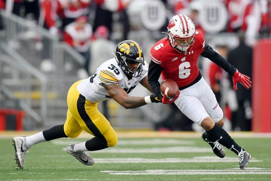 Barrington Wade, left, was part of Iowa's 4-4-3 alignment that tried to stop Wisconsin and Danny Davis (6).