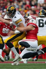 Wisconsin's Matt Henningsen sacks Iowa's Nate Stanley during the first half of an NCAA college football game Saturday, Nov. 9, 2019, in Madison, Wis. (AP Photo/Morry Gash)