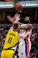 Detroit Pistons center Andre Drummond (0) shoots over Indiana Pacers forward Domantas Sabonis (11) during the first half of an NBA basketball game in Indianapolis, Friday, Nov. 8, 2019. Sabonis (17 points, 14 rebounds, 6 assists) held his own vs. Drummond.