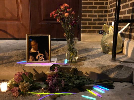 Flowers, glow sticks and a candle lie by a photo of Julie Morey, who was found dead Nov. 3 inside the St. Patrick Catholic Church.