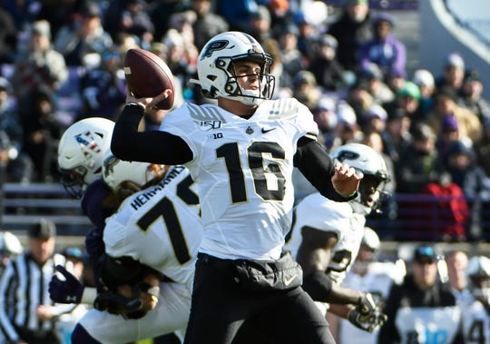 Purdue Boilermakers quarterback Aidan O'Connell (16) passes against the Northwestern Wildcats during the first quarter at Ryan Field.