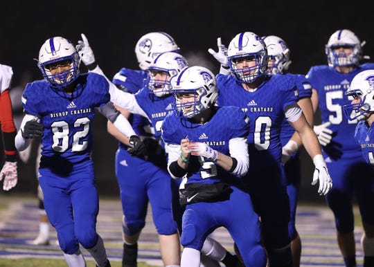 Bishop Chatard's Kyle Cheek (5) celebrates a touchdown against West Lafayette in the Class 3A sectional final game at Bishop Chatard High School in Indianapolis on Nov. 8, 2019.  Bishop Chatard defeated West Lafayette 42-14.