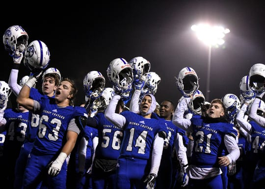 Bishop Chatard celebrates with their fans by singing the school anthem after their win against West Lafayette in the Class 3A sectional final game at Bishop Chatard High School in Indianapolis, Ind., Friday, Nov. 8, 2019. against the Bishop Chatard defeated West Lafayette 42-14.