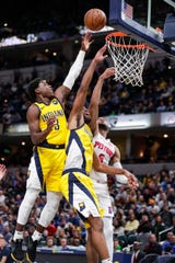 Aaron Holiday (3) is still finding his way as he begins his second pro season.