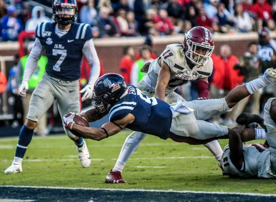 Ole Miss running back Jerrion Ealy (9) dives for a touchdown against New Mexico State. He plans to play for the Ole Miss baseball team, too.