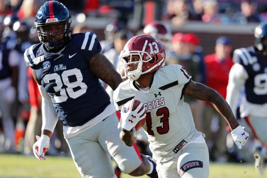 Ole Miss defensive end Austrian Robinson (38) chases New Mexico State wide receiver Tony Nicholson.