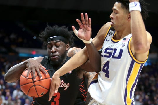 Bowling Green guard Caleb Fields (3) and LSU guard Skylar Mays (4) battle for the ball in the second half of an NCAA college basketball game in Baton Rouge, La., Friday, Nov. 8, 2019. (AP Photo/Brett Duke)