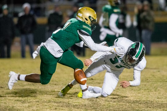 Acadiana High's Jerimiah Brown forces a fumble during the play as the Acadiana High Wreckin' Rams take on the Lafayette High Mighty Lions on Senior Night, Thursday, Nov. 8, 2019.