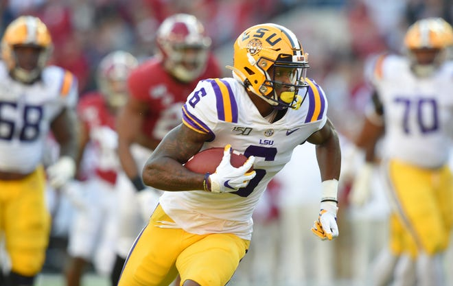 Nov 9, 2019; Tuscaloosa, AL, USA; LSU Tigers wide receiver Terrace Marshall Jr. (6) carries for a touchdown during the second quarter against the Alabama Crimson Tide at Bryant-Denny Stadium. Mandatory Credit: John David Mercer-USA TODAY Sports