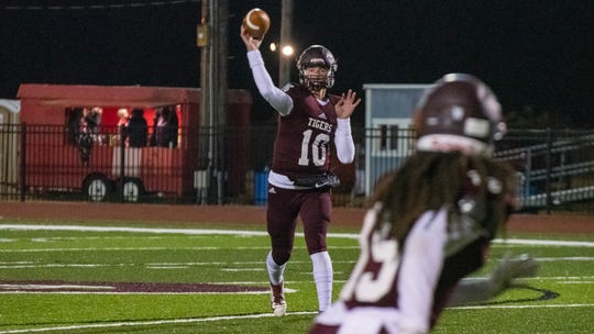 Breaux Bridge quarterback Gavan Courville (10) throws a pass as the Tigers take on the Livonia High Wildcats Friday, Nov. 8, 2019.