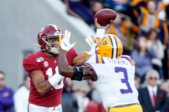 Nov 9, 2019; Tuscaloosa, AL, USA; Alabama Crimson Tide quarterback Tua Tagovailoa (13) throws a pass against LSU Tigers safety JaCoby Stevens (3) during the first half at Bryant-Denny Stadium. Mandatory Credit: Butch Dill-USA TODAY Sports