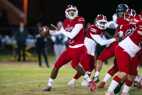 Comeaux High quarterback Tre Harris prepares to throw a pass to an open receiver as the Comeaux High Spartans take on the Barbe High Buccaneers on Senior night, Thursday, Nov. 8, 2019.