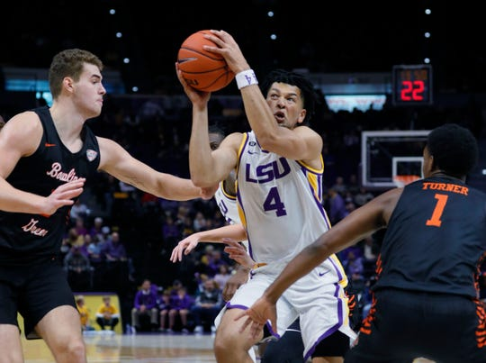 Nov 8, 2019; Baton Rouge, LA, USA;  LSU Tigers guard Skylar Mays (4) drives to the basket against Bowling Green Falcons guard Justin Turner (1) during the first half at Maravich Assembly Center. Mandatory Credit: Stephen Lew-USA TODAY Sports