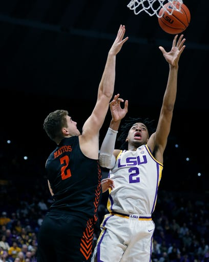 Nov 8, 2019; Baton Rouge, LA, USA;  LSU Tigers forward Trendon Watford (2) shoots a lay up agbasint Bowling Green Falcons center Tayler Mattos (2) during the first half at Maravich Assembly Center. Mandatory Credit: Stephen Lew-USA TODAY Sports