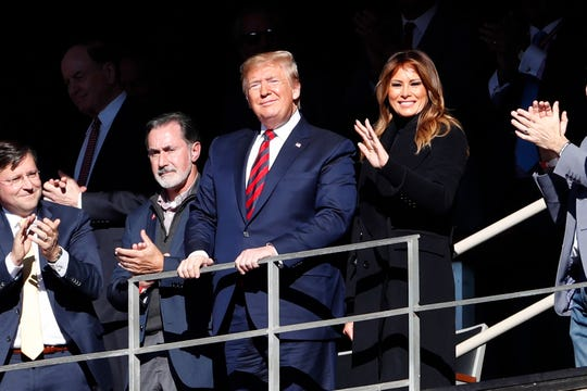 President Donald Trump watches the first half of an NCAA football game between Alabama and LSU with his wife Melania Saturday, Nov. 9, 2019, in Tuscaloosa, Ala. Also pictured in the far left is Louisiana Congressman Mike Johnson, R-Benton. (AP Photo/John Bazemore)