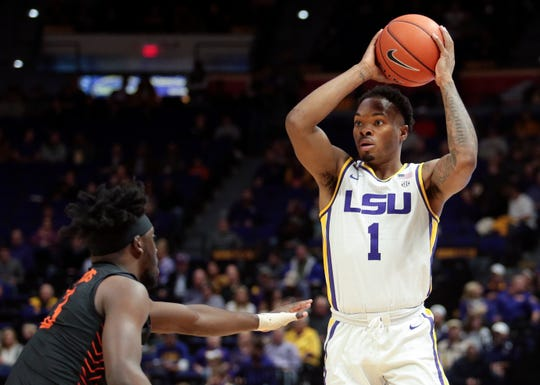 LSU guard Javonte Smart (1) prepares to pass the ball as Bowling Green guard Caleb Fields (3) defends in the first half in an NCAA college basketball game in Baton Rouge, La., Friday, Nov. 8, 2019. (AP Photo/Brett Duke)